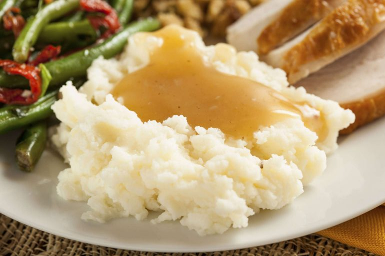 The best basic pan gravy on top of mashed potatoes | Thanksgiving.com