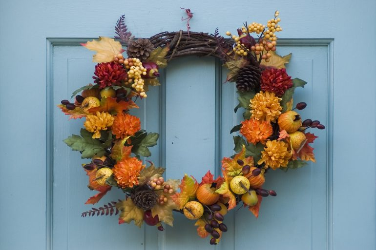 Thanksgiving wreath on a blue door
