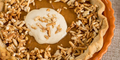 Pumpkin pie with harvest-spiced cream & caramelized almonds