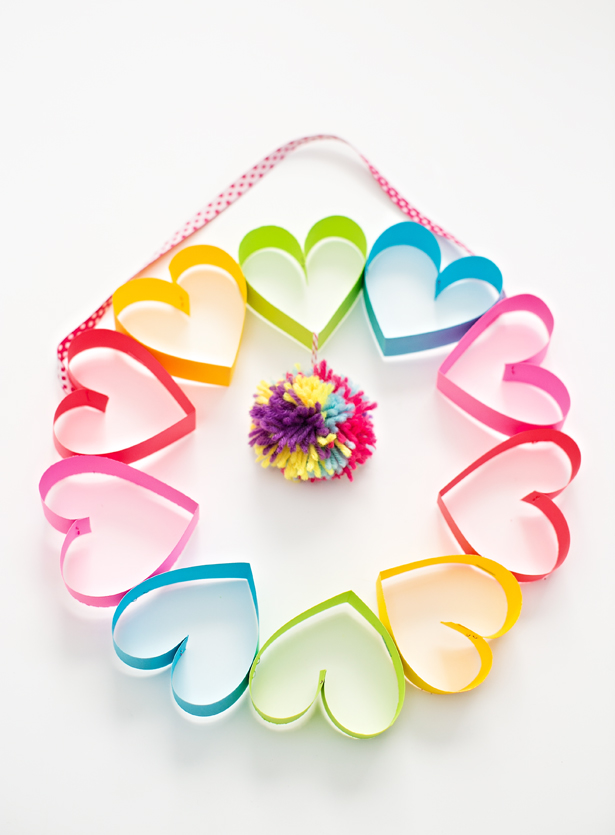 DIY rainbow paper heart pom pom wreath