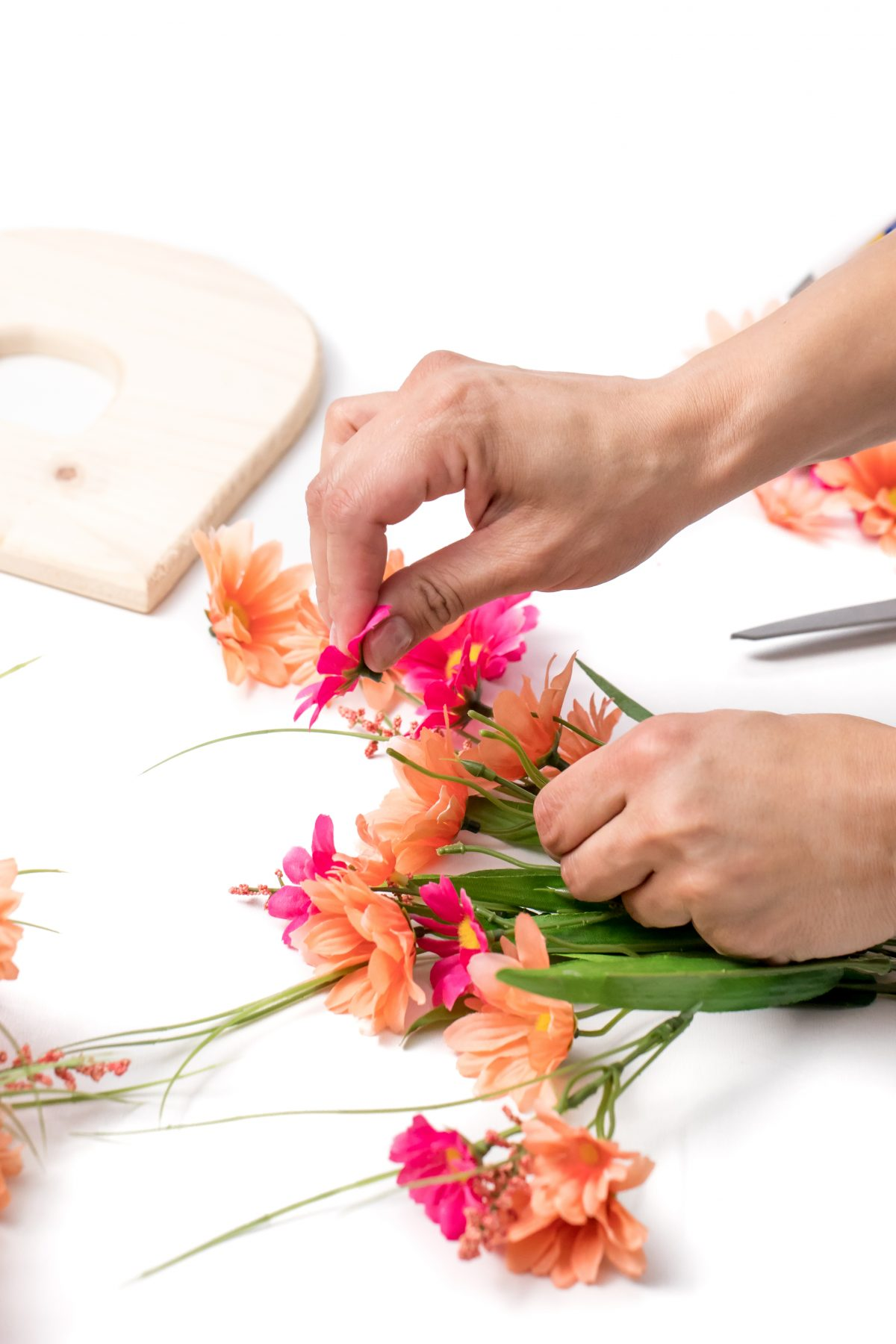Remove flowers from stems for floral letter craft