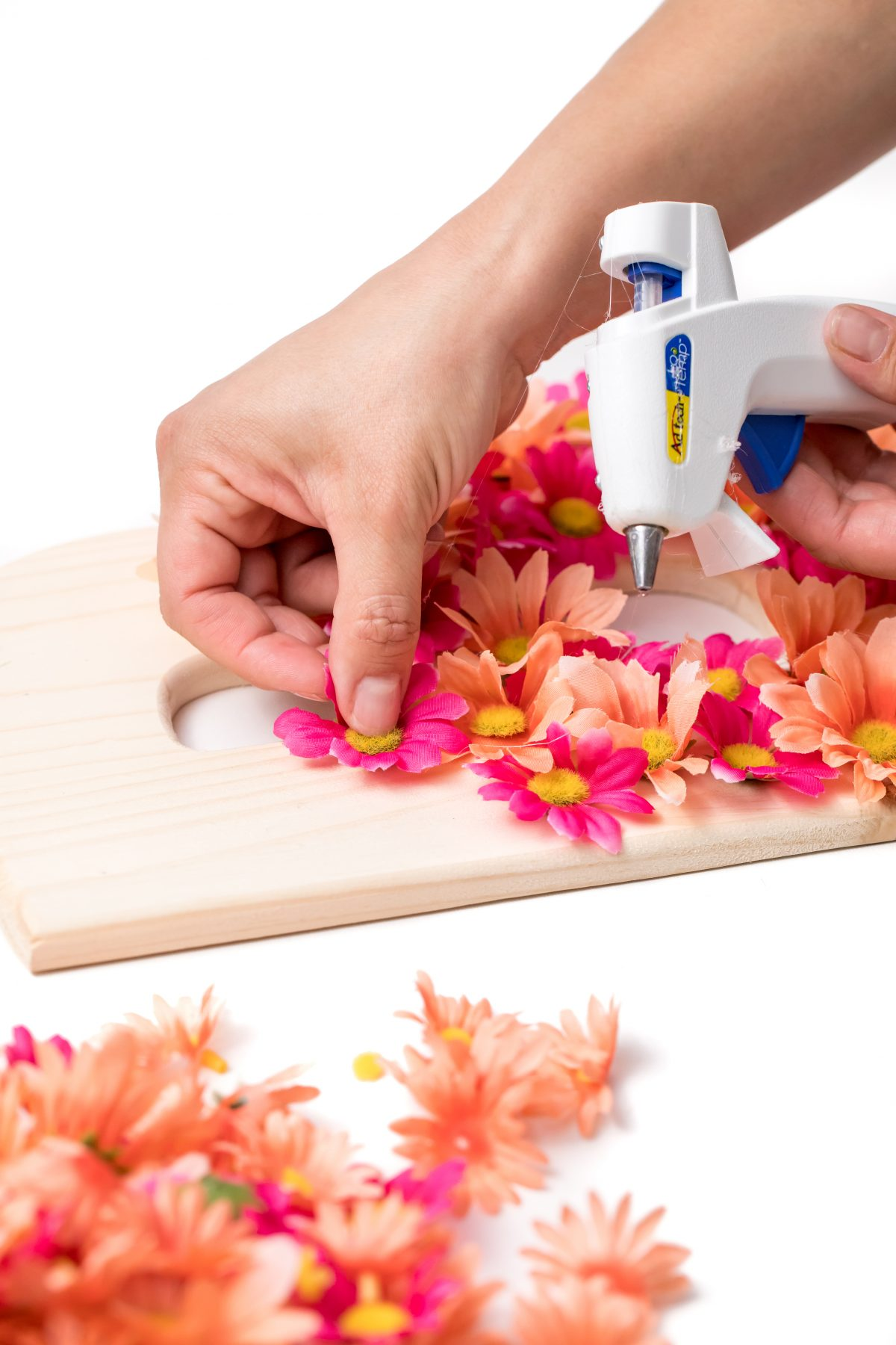 Press each flower down onto wooden letter allowing glue to dry