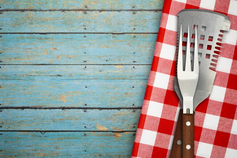 BBQ Utensils on Blue Rustic Picnic Table