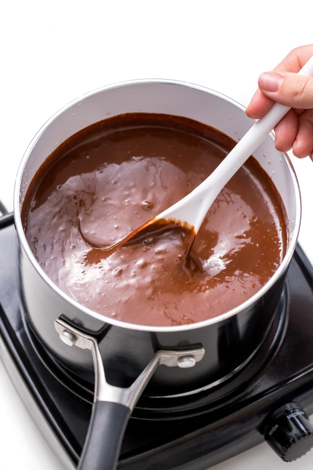 Stirring until smooth and fully melted