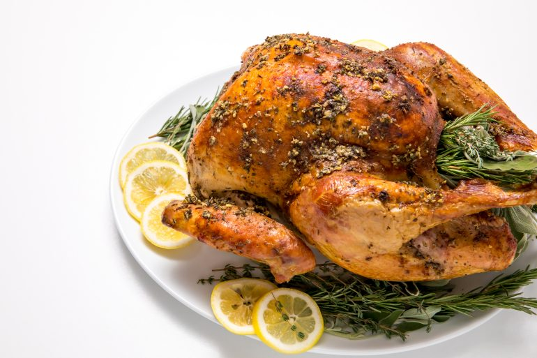 5D4B5461 - Easy No fuss Thanksgiving Turkey - turkey on a plate with lemon slices