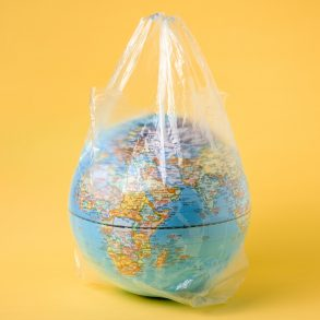 globe model in plastic bag, save the world environment
