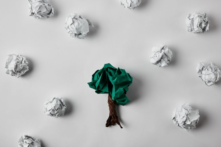 Ball of paper shaped into a tree on white background