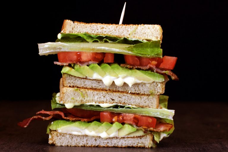 Stacked BLT sandwich with avocado