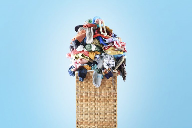huge pile of clothes on blue background