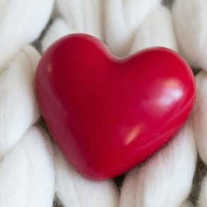 relationship questions heart on knitted background