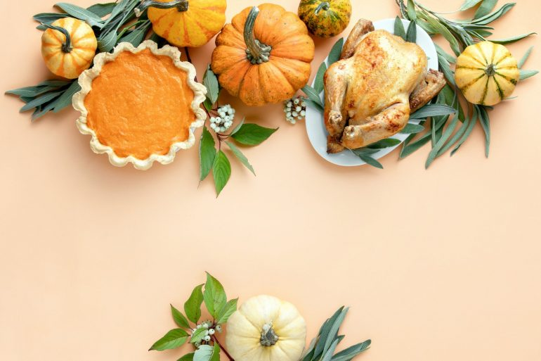 turkey pumpkins and pumpkin pie flat lay holiday food